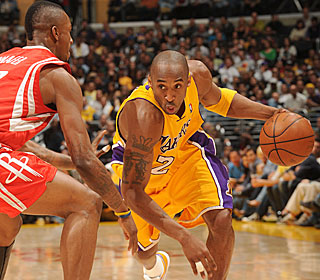 Kobe Bryant doesn't feel the need to pour it on the Rockets, settling for 20 points.  (Getty Images)