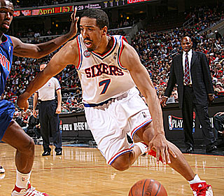 Andre Miller does a little bit of everything, getting 21 points, 12 assists and 10 boards.  (Getty Images)