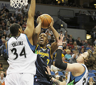 Chauncey Billups (17 points) and the Nuggets have an easy time routing the depleted T-Wolves.  (AP)