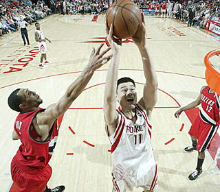 Yao Ming goes for 21 points and 12 boards, putting a damper on Portland's playoff party.  (Getty Images)