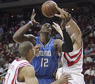 Yao Ming and the Rockets keep Dwight Howard (13 points) in check for much of the game.  (AP)