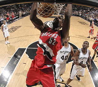 Greg Oden, who slams home two of his eight points, also finishes with eight boards.  (Getty Images)
