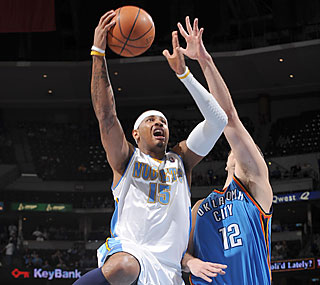 'Melo (31 points) propels the Nuggets to their eighth straight win and ninth straight at home.  (Getty Images)