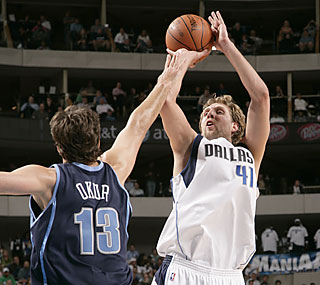 The Jazz can't slow down Dirk Nowitzki, who scores 31 points in the playoff-clinching effort.  (Getty Images)