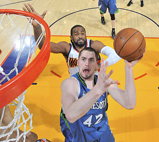 The T-Wolves' Kevin Love returns from the flu and finishes with his 27th double-double.  (Getty Images)