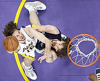 The Gasol brothers square off one more time, with the Lakers' Pau (left) getting the better of Marc.  (AP)
