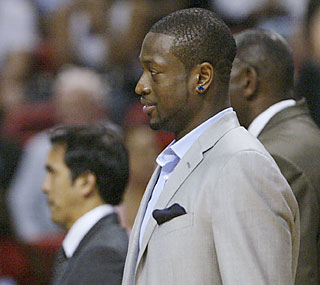 D-Wade picks up his first scoring title in style as he watches his Heat close out the season with a win.  (AP)