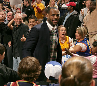 While LeBron spends time with fans, his Cavs fail to tie Boston's all-time home record of 40-1.  (Getty Images)