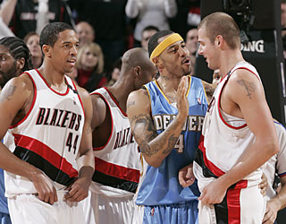 Kenyon Martin eases Joel Przybilla as the Blazers win, yet finish below Martin's Nuggets. (Getty Images)