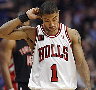 After contemplating this loss, Derrick Rose and the Bulls must find a way to beat the mighty Celtics.  (AP)