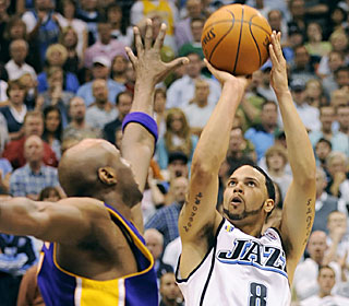 Deron Williams scores only 13 points, but hits the winner over Lamar Odom with 2.2 ticks left.  (AP)