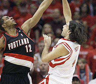 Rockets power forward Luis Scola battles in the post for 19 points and nine rebounds.  (AP)