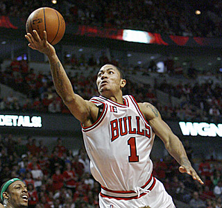 Derrick Rose nearly gets a triple-double, scoring 23 points with 11 rebounds and nine assists.  (AP)