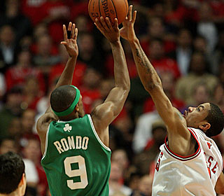 Derrick Rose gets just enough of Rajon Rondo's winning attempt to keep the Bulls alive.