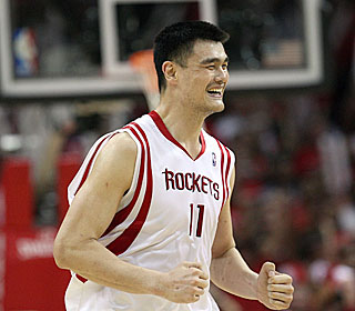 Yao Ming can smile now after getting to the second round for the first time in his career. (Getty Images)