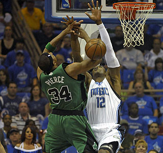 Dwight Howard, who finished with five blocks, contests a shot by Celtics star Paul Pierce. (AP)