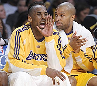 With the game well in hand, Kobe Bryant gets to spend plenty of time cheering on Los Angeles' reserves from the bench.