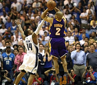 Derek Fisher, who finishes with 12 points, hits a tying 3 over Jameer Nelson with 4.6 seconds left in regulation.