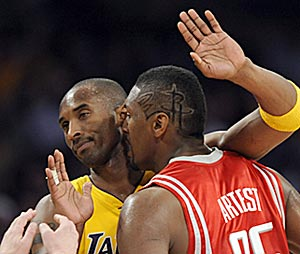 After scenes like this in early May, it didn't seem possible that Kobe Bryant and Ron Artest could soon become teammates. (AP)