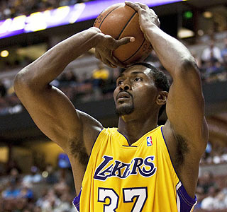 Ron Artest begins his Lakers career with a 12-point, nine-rebound, seven-assist preseason outing.  (AP)