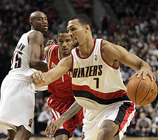 Travis Outlaw (left) and Brandon Roy combine for 43 points as the Blazers win their season opener.  (AP)