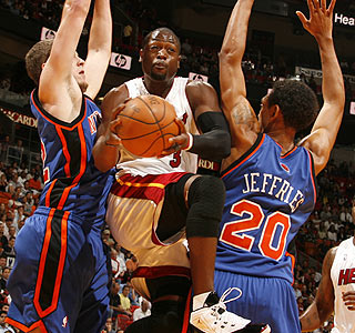 Dwyane Wade, last season's scoring champ, leads the way for Miami with 26 points in the win.