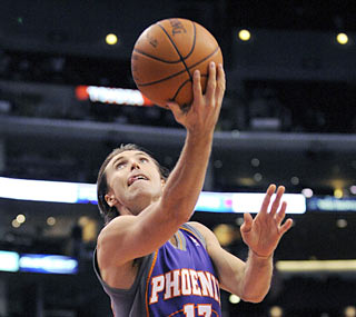 The Suns are happy to have Steve Nash, who provides 15 points in the fourth, including the game-winner.  (AP)