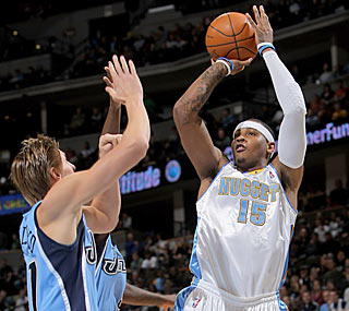 Carmelo Anthony tips off the season with 30 points along with eight boards and five dimes. (Getty Images)