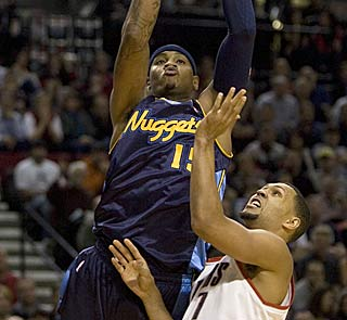 Carmelo Anthony does his thing, and also gives the Nuggets a lift by making 18 of 19 free throws.  (AP)