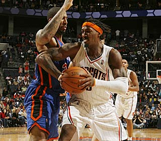 Gerald Wallace has a rough game from the field (4 of 20) but still puts up 18 points and 15 boards. (AP)