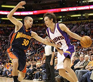Steve Nash shows rookie Stephen Curry some veteran moves, handing out 20 assists.  (Getty Images)