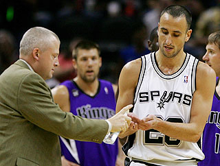 Manu Ginobili stops for hand sanitizer after swatting a bat out of the air and then scooping it up.
