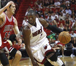 Dwyane Wade scores 25 to push his career total to 10,005, the first Heat player with that many.  (AP)