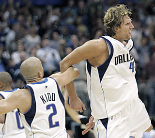 Dirk Nowitzki's 29-point fourth quarter gives Jason Kidd and the Mavs something to celebrate.  (AP)