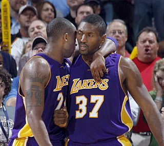 Kobe Bryant tries to calm down new teammate Ron Artest after he gets fouled hard.  (Getty Images)