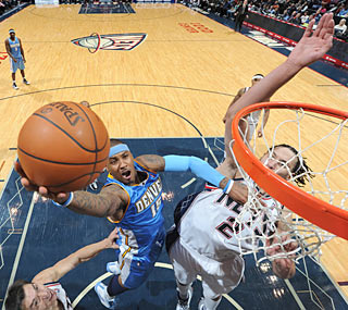'Melo, who scores 22 points, provides a needed spark in the Nuggets' 44-point third quarter.  (Getty Images)