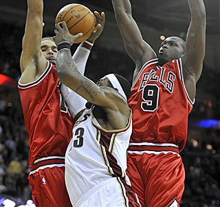 Here's the play in question. You make the call: Did Joakim Noah (left) foul LeBron James?  (US Presswire)