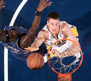 Tyler Hansbrough, the Pacers' first-round draft pick, scores 13 points in his debut.  (Getty Images)