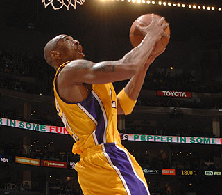 Kobe Bryant is the youngest player to reach 24,000 points as L.A. wins its fourth straight. (Getty Images)