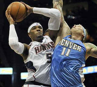Josh Smith does it all, posting 22 points, nine rebounds, seven assists and six blocked shots. (AP)