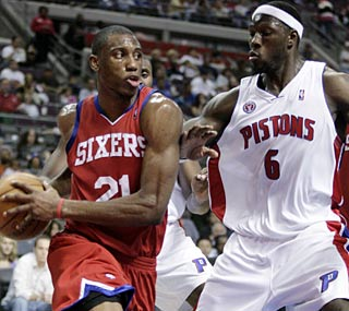 Detroit's Ben Wallace makes his presence felt on defense against the 76ers.  (AP)