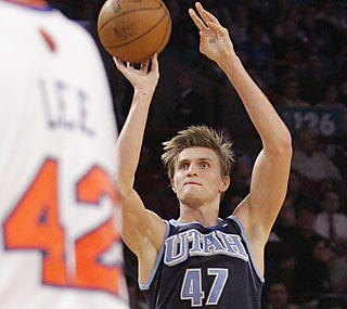 The Knicks can't get Andrei Kirilenko off their backs. AK-47 posts 23 points, six boards and six dimes. (AP)