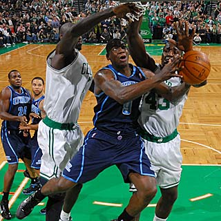 Kevin Garnett and Kendrick Perkins swarm Ronnie Brewer as he goes up for layup. (Getty Images)