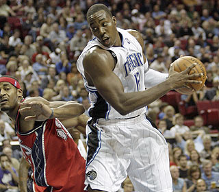It's another night at the office for Dwight Howard, who racks up 26 points with 12 rebounds. (AP)