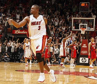 Dwyane Wade revels in the moment after drilling the winning 3-pointer with 0.1 seconds left. (Getty Images)