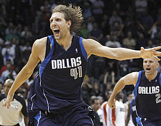 The Mavs' Dirk Nowitzki finishes with 32 points, but none are more important than his final two. (AP)