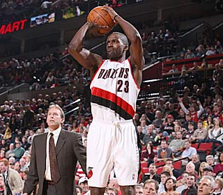 All T-Wolves coach Kurt Rambis can do is look on as Martell Webster and the Blazers cruise.  (Getty Images)