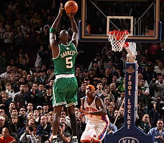 The Knicks defense is caught by surprise as Kevin Garnett buries the winning shot in OT.  (Getty Images)