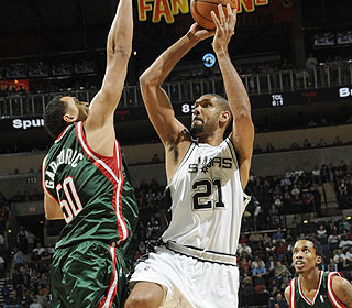 It takes 24 points and 12 boards from Tim Duncan, but the Spurs climb back to .500. (Getty Images)