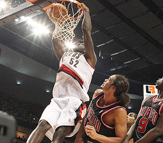 Out of the way, Joakim. It's dunk time for Greg Oden, who ties a career high with 24 points. (US Presswire)